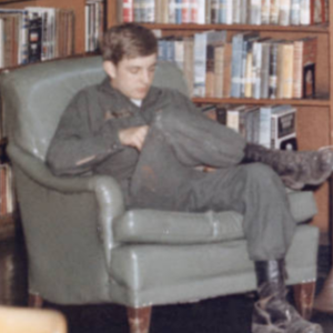 Soldier reading in library