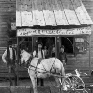 Exterior of old store with horse and caridge