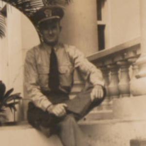 Sailor seated on steps